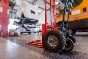 Picture of manual hand forklift in car workshop.