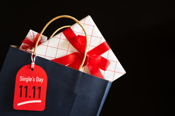 Online shopping of China, 11.11 single day sale concept. Shopping bag and gifts boxes with message tag.