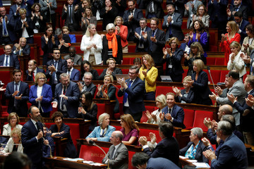 French Prime Minister Edouard Philippe, appointed interim Interior Minister, is applauded by members of Parliament during a questions to the government session at the National Assembly in Paris