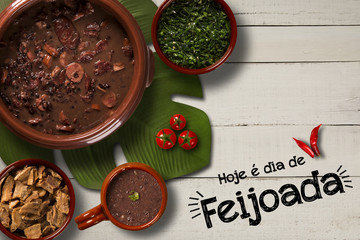 "Brazilian Feijoada Food. Written ""Today is Feijoada's Day"" in Portuguese. Top view with copy space."