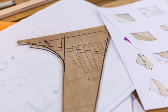 Eco friendly woodworker's shop. sketches and plans on paper or wood, while making legs for a designer coffee table. Mastering woodery with peacefullness.