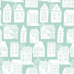 Hand drawn seamless pattern with doodle houses, vector background with cartoon town