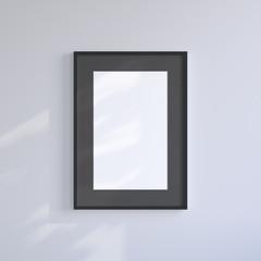 Black blank frame on the light gray wall. Frame mock up.