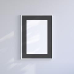 White blank frame on the light gray wall. Frame mock up.