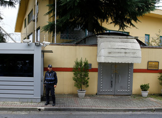 A Turkish police officer stands guard outside the Saudi Arabia's consulate in Istanbul