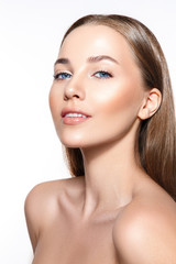 Beautiful woman portrait with fresh clear skin and nude make up.