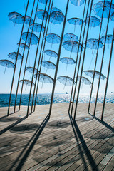 The seafront in the city of Thessaloniki, Greece. Mediterranean Sea,performance on the beach with umbrellas