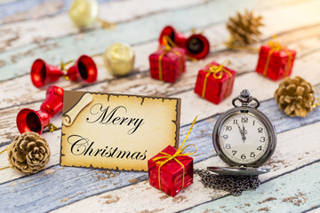 Greeting card for new year or christmas with pocket watch and christmas decorations