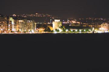 Beach in the evening of Thessaloniki, Greece.Night lanterns. The light of the night city.