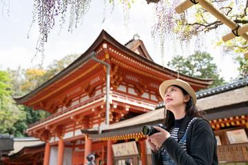 traveler taking photo of the flowers