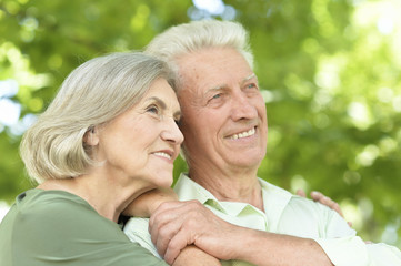 Portrait of happy mature couple smiling and hugging outdoors