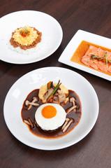 Japanese spicy Tan Tan pork over rice, salmon tataki salad and hamburger steak with sunny side up egg