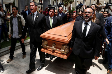 Lawmakers carry the coffin of Fernando Alban during a ceremony at the National Assembly in Caracas