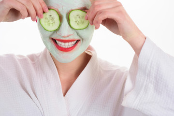 Woman with mask on face. Woman in spa. Beauty Treatments. Facial clay mask. Spa. Cosmetic mask. Spa treatments. Health. Clean skin. Mask with cucumber slices. Cucumber slices on eyes. Closeup.