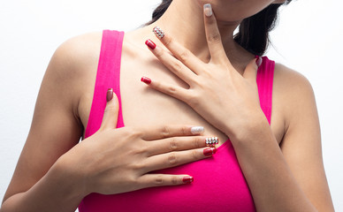 Women are showing red nails.