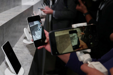 A person takes a photo of the Google Pixel 3 third generation smartphones on display after a news conference in Manhattan