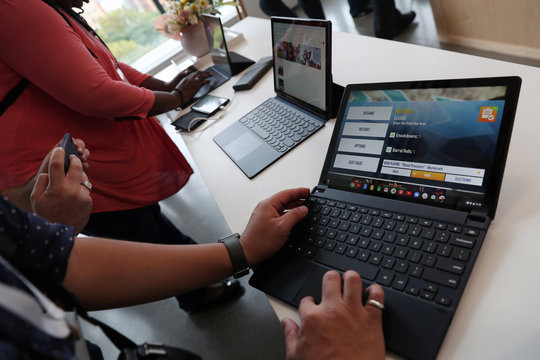 People test the Google Pixel Slate after a news conference in Manhattan, New York