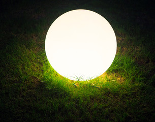 LED ball in the grass at night, close up.