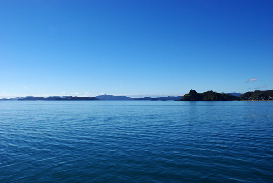 View of the sea and islands from a boat in Bay of Islands, New Zealand.