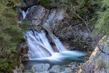 Beautiful waterfall Wodogrzmoty Mickiewicza in Polish Tatra mountains near Zakopane Im Poland. Mountain stream cascade long time exposure photography.