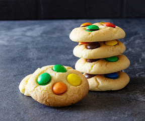 Pile of homemade cookies with rainbow candies