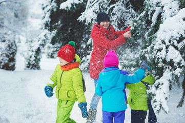 the boy in snow in the Park. A boy plays in winter Park. Adorable child walking in snow winter forest