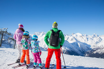 family in alpin ski resort