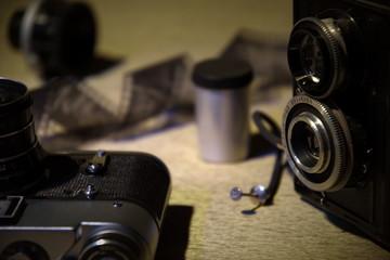 Old cameras, lens, film tape.Bokeh background