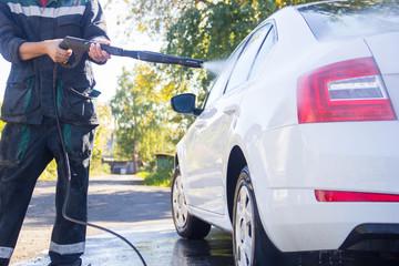 car wash. car wash. man washes the car