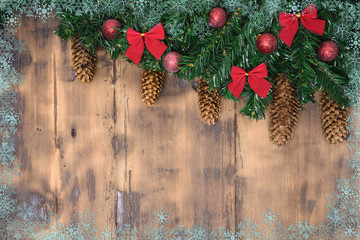 Decorated wooden background with Christmas tree branches with cone