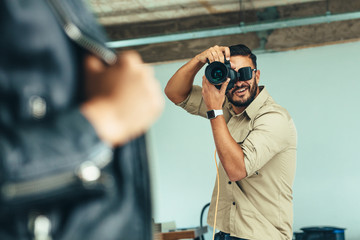 Photographer taking photographs of a model