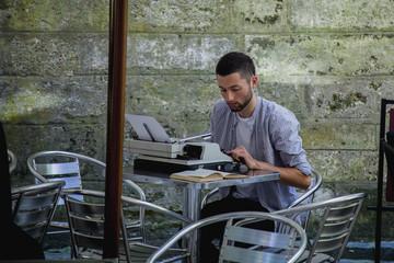 Journalist typing on an antique vintage typewriter machine