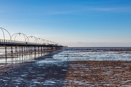 Southport beach and the old pier, at low tide on a sunny evening
