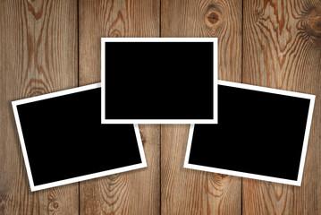 three polaroid on wood background