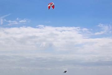 kitesurfer jumping on his board