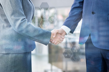 Handshake as a result of an agreement between businessmen .