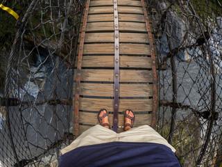 Man on bridge at he Changchun Trail at Taroko Gorge National Park in Taiwan
