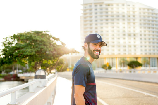 Young man smiling at the streets of Miami