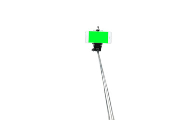 Selfie stick and smartphone on an isolated white background