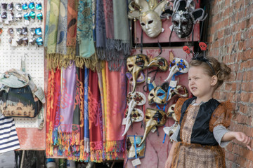 Little girl dressed up for Halloween in Venice Italy