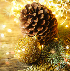 Christmas background. Christmas fir tree and decorations on wooden background.