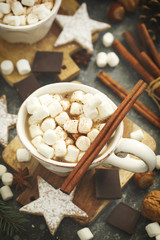 Hot chocolates with marshmallows and Christmas cookies