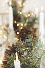 Christmas candles on holiday table