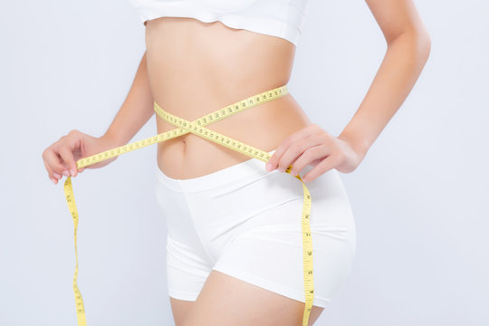 Asian woman diet and slim with measuring waist for weight isolated on white background, girl have cellulite and calories loss with tape measure, health and wellness concept.