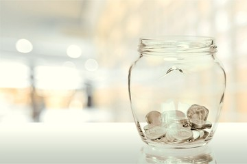 Money Jar with  coins on white background