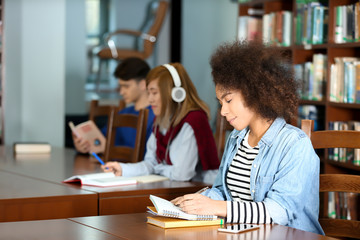 African American student studying in library