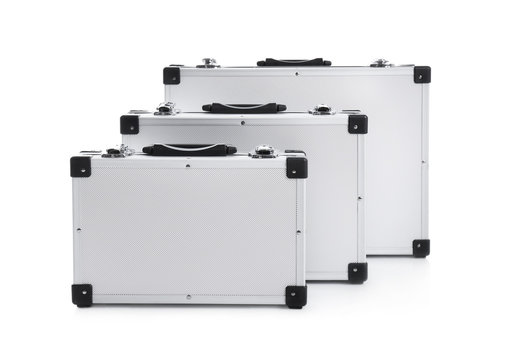 Set of modern suitcases on white background
