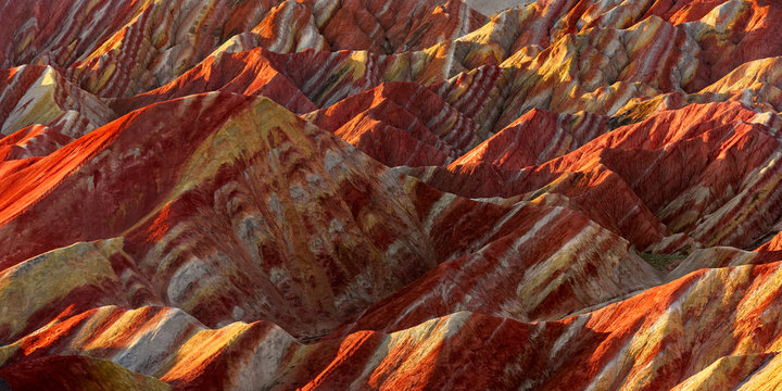 Zhangye Danxia National Geopark - Gansu Province, China. Chinese Danxia multicolor danxia landform, rainbow hills, colored rocks, sandstone erosion, layers of Red, Yellow and Orange stripes. 张掖