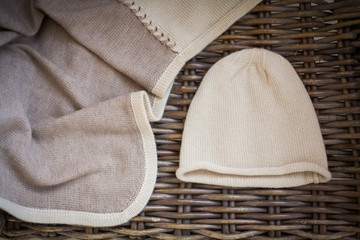 Knitted cashmere products are on the wicker furniture