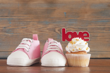 Delicious birthday сupcakes for a baby shower on wooden background